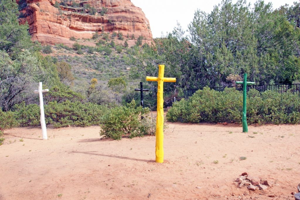 Four crosses on a trail.