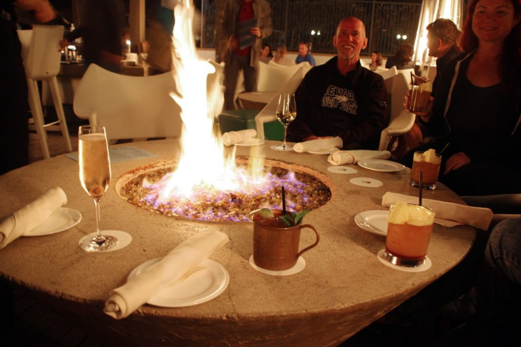 Eat dinner around a fire pit.
