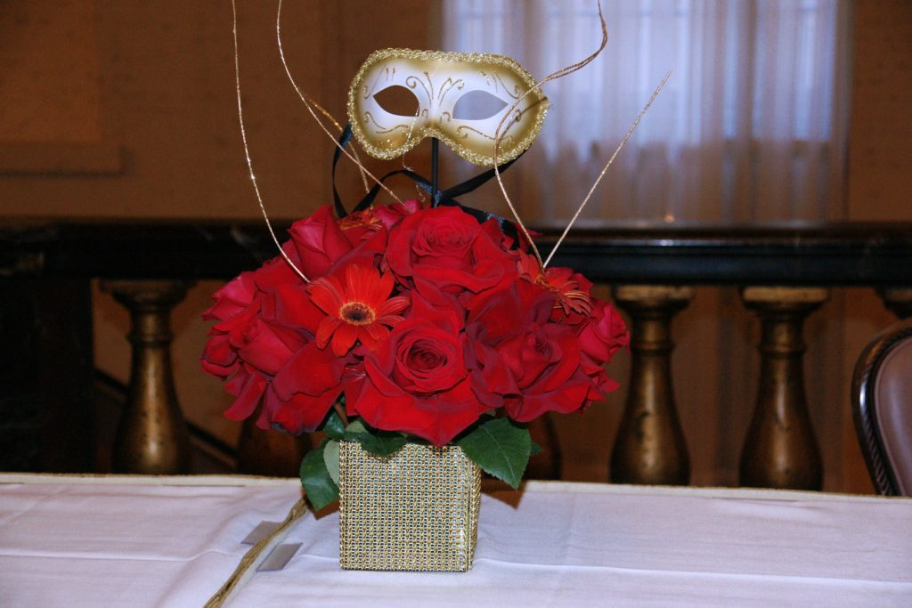 Red roses and a mask…hmmmmmm.