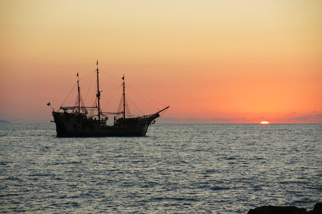 A pirate crew enjoys the sunset.