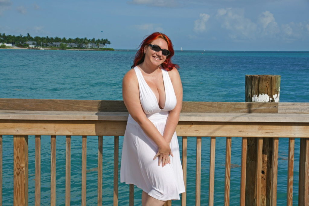 On the Key West boardwalk in a Marilyn Monroe dress.