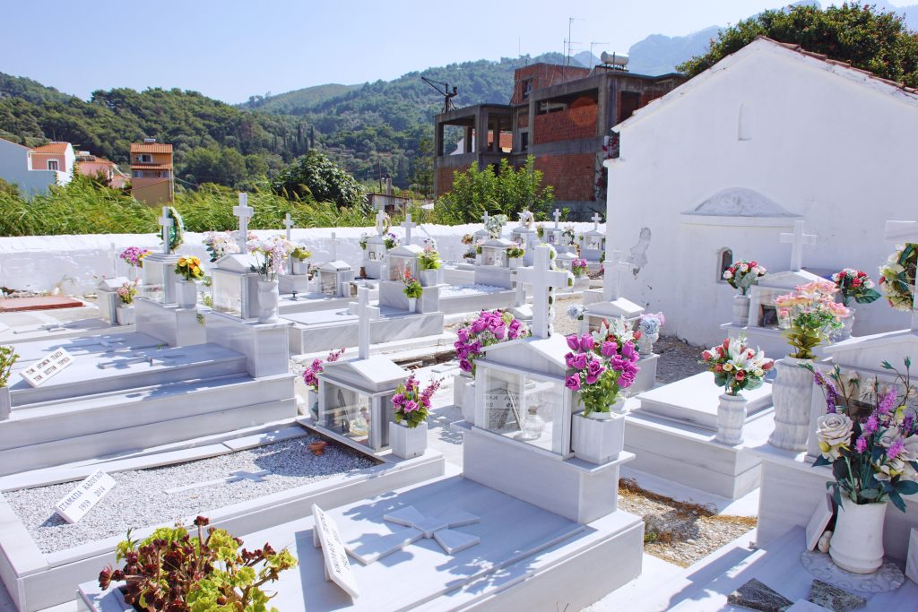 We practice reading in Greek at the local cemetery.