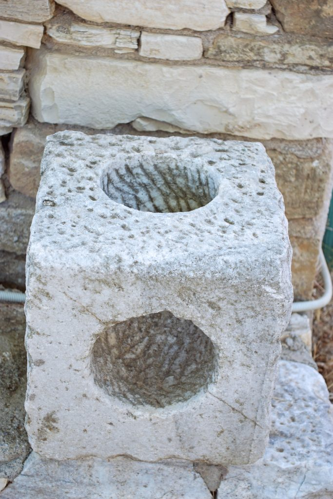 This cubic stone has a curved tunnel carved through it.