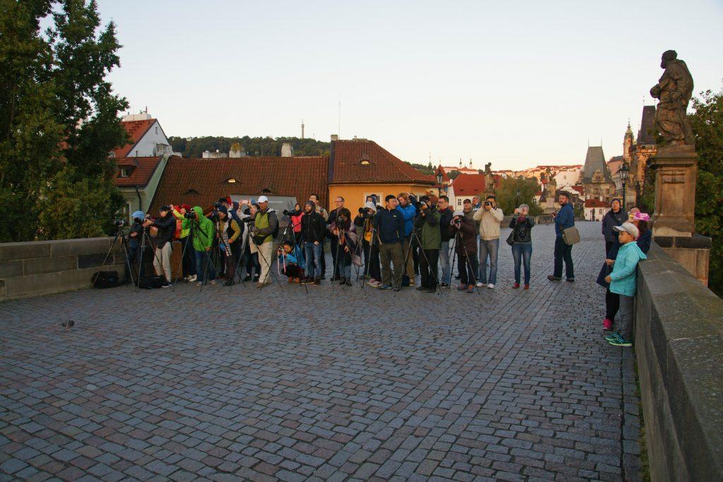 A mob of photographers awaits the sunrise.