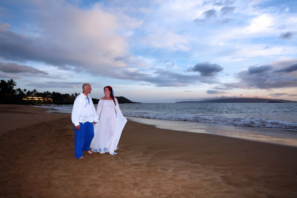 Newlyweds, walking on our private beach.